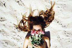rose with roses (Lena Kanshyna) Tags: 35mm film filmphoto roses girl beach hair longhair love summer sunny olympus olympusmju2 mju2 mjuteam mju kodakgold ukraine odessa lying sea seaside kanshyna flowers