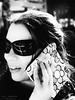 _ZA07079 (zalo_astur) Tags: llamada telefono movil celular gafas sol mujer mano luarca