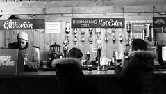 festive market at night 03 (byronv2) Tags: edinburgh edinburghbynight night nuit nacht festivemarket christmasmarket market princesstreetgardens princesstreet mound newtown blackandwhite blackwhite bw monochrome peoplewatching candid street winter stall shop shopping food drink drinking