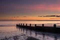 Low Tide Sunset (Sunset Snapper) Tags: lowtidesunset sunset sandypoint haylingisland hampshire southcoast uk beach sand shingle lowtide groyne clouds reflections filter lee nd grad nikon d810 seascape november 2017 sunsetsnapper