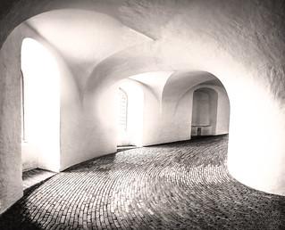 Captured in fine art black & white, light floods into the spectacular Roundtower, Copenhagen, Denmark.