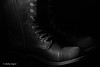 Combat Boot: Black on Black, Texture View (Photographs by Shelly Fegter) Tags: advertising blackboots blackonblack combatboots leatherboots leathershoes lowkey pink productimages stilllife studiolighting