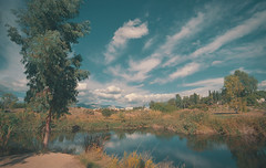 East of neverland (aris paizanos-mavrakis) Tags: fairytale dreamy neverland clouds puffyclouds reflections scenery analog film slr olympus tokina 17mm om1 olympusom1 ultrawideangle wide kodak ektar 100asa greece nature ngc