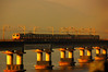 Mumbai bound (Debmalya Mukherjee) Tags: trains railway mumbai canon550d 18135 debmalyamukherjee morning sunrise vashi creek bridge