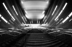 Looking up to the skies / a special station (Özgür Gürgey) Tags: 12mm 2017 bw d750 hamburg nikon samyang architecture escalator fisheye grainy reflection silhouette stairs station subway symmetry überseequartier germany