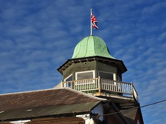 Brooklands Automobile Racing Club (BARC) clubhouse observation tower, 1907 (edk7) Tags: olympusomdem5 edk7 2017 uk england surrey weybridge brooklandsmuseum architecture building oldstructure metal brooklandsautomobileracingclubbarcclubhousetower1907 octagonal copperroofed observationtower wood timber balustrade railing crusty roof dome unionflag flag flagpole gradeiilisted cloud sky