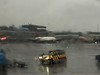Schiphol in the rain (Observe The Banana) Tags: 1374 amsterdam airport rain schiphol