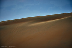 Shades of gold (Paterdimakis) Tags: desert sand hill arabia sun curve nature landscape fuji color sky sandhill shape cloud beautiful slope travel