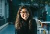 (·Nicolás) Tags: girl glasses eyes smile curl hair sun light natural café breakfast