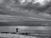 The sea fisherman (Tim Ravenscroft) Tags: fishing fisherman shore beach sea clouds stormy monochrome blackandwhite blackwhite hasselblad hasselbladx1d x1d