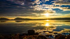 Golden Reflection (Superali007) Tags: canon canon7d clouds efs1585mmf3556isusm ecosse sunset sunsetting landscape invernessshire inverness highlands scotland scenic sky lochduntelchaig sunburst aun sunflare golden reflection