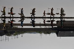 on queue (PawL23) Tags: petchaburi saltfields workers asia thailand 76000 silhouette reflection