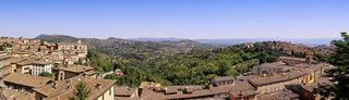 Perugia lifted by a hill above a valley patterned with fields