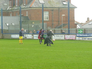 Pete takes pictures of the penalty shoot-out.