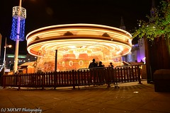Carousel. (The friendly photographer.) Tags: carousel amusement amusements fairground fantasticphoto flickrcom funfair fairgroundrides art arty artistic artwork britain brilliant brilliantphoto candid city colour d7100 dark england evening flickr google googleimages gb greatbritain greatphotographers greatphoto image images interesting imageblur leeds ls1 leedscitycentre lighttrails mamfphotography mamf motionblur millenniumsquare nikon nikond7100 northernengland north photography photo photograph people person town uk unitedkingdom upnorth westyorkshire