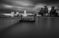 Canary wharf in front of Rotherhide Ferry Terminal (www.davidrosenphotography.com) Tags: canarywharf river thames longexposure blackandwhite bw water seascape buildings skyline london