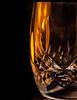 Candlelit crystal shotglass (Jack Blackstone (Off and on)) Tags: reflection bokeh macro candlelit macromondays waterford crystal color vibrant shotglass