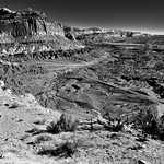 Standing on the Edge of the Waterpocket Fold of Capitol Reef National Park (Black & White) thumbnail