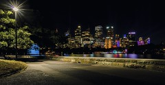 City skyline by night, Sydney, Australia (Victor Wong (sfe-co2)) Tags: architecture australia bay building city cityscape coastline colorful colors destination evening famous footpath harbor harbour highresolution historic holiday icon lamp landmark landscape lights longexposure monument new newsouthwales nightshot nsw pathway pavement post quiet reflection scenic sea skyline skyscraper south sydney symbol timeexposure tourism travel urban wales walkway waterfront quietude calm