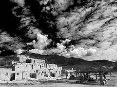 Pueblos (adamfreeman) Tags: taos pueblos new mexico nm adobe sky black white