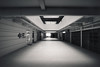Empty (OzGFK) Tags: asia fomapan hdb nikon nikonfm2n singapore tokinalens blackandwhite building bw monochrome urban film analog 35mm streetphotography fomapan100 pushed hallway corridor
