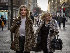Prowling (Leanne Boulton) Tags: portrait people urban street candid portraiture streetphotography candidstreetphotography candidportrait streetportrait streetlife woman women female girl face faces facial expression look feeling mood confidence mother daughter coat animal print leopard fur furry fashion style stylish bodylanguage blonde tone texture detail depthoffield bokeh naturallight outdoor light shade shadow city scene human life living humanity society culture lifestyle canon canon5d 5dmkiii 70mm ef2470mmf28liiusm color colour glasgow scotland uk