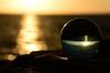 A round world... (Raquel Borrrero) Tags: crystal ball bola cristal sunset clouds sea atardecer mar nubes sol sun soleil océano atlántico ocean reflections reflejos nikon rocas rocks cielo sky ciel sunshine sunrays sunlight rayosdesol esfera