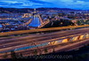 Amanecer en Bilbao (Iñigo Escalante) Tags: sunrise city cityscape lights road traffic bridge pedestrian long exposure street light amanecer pais vasco ciudad luces bilbao blue hour overpass euskadi ria pyrmont downtown district elevated trafico torre iberdrola san mames campo futbol