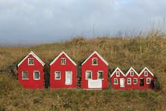 Elf Houses, Suðurland (South Iceland) (Mike Sirotin) Tags: grass iceland houses travelphotography travel ísland small southiceland elfhouses elf suðurland tiny white red