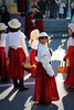 St Martin's Fair (overthemoon) Tags: switzerland suisse schweiz svizzera romandie vaud vevey stmartin foiredelastmartin stmartinsfair grenette girls red skirts hats waiting candid sunlight shadows costumes traditions traditional