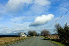 Under a Brooding Sky (gabi-h) Tags: princeedwardcounty road rural clouds sky whiteclouds gabih november trees driving farmland landscape