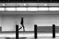 Along shutters (pascalcolin1) Tags: paris13 homme man austerlitz mur wall volets shutters photoderue streetview urbanarte noiretblanc blackandwhite photopascalcolin 50mm canon50mm canon