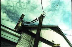 Power Hookup (Beaulawrence) Tags: film analog lomography lomo grain slidefilm slide crossprocessed xpro pentax k1000 slr vintagecamera kodak ektachrome 200asa expired aristac41 homedeveloped diy doityourself homedarkroom vancouver britishcolumbia canada explorebc factory powerline electricity hookup detail alley industry eastvan