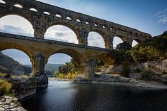 Pont du Gard (cliveg004) Tags: pontdugard roman aqueduct rivergardon river bridge backlit sun water ancient worldheritagesite france nikon d5200
