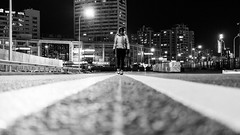 Line up (Go-tea 郭天) Tags: qingdao huangdao lady woman young cold winter night lines road new empty alone lonely walk walking middle dark buildings candid movement street urban city outside outdoor people bw bnw black white blackwhite blackandwhite monochrome naturallight light asia asian china chinese shandong canon eos 100d 24mm prime