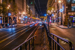 just passing by (pbo31) Tags: bayarea california nikon d810 november fall 2017 dark night boury pbo31 city urban sanfrancisco color lightstream motion traffic latenight infinity marketstreet downtown financialdistrict bus muni publictransit busstop kearnystreet streetlights orange