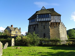 Stokesay Castle and cemetery (Dunnock_D) Tags: uk unitedkingdom britain england shropshire stokesay castle blue sky white clouds gatehouse