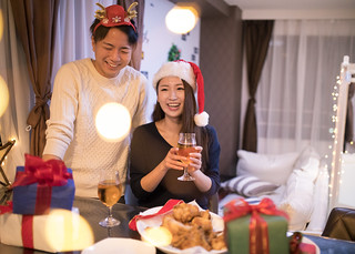 Young couple having Christmas party at home