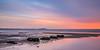 Elie Sunrise.jpg (cmonthebeanos) Tags: water stones sky beach sunrise sea orange elie