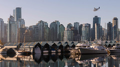 Over the Marina (Sworldguy) Tags: vancouver coalharbour boats yaght seaside skyline city reflections marina moorage shelter cityscape otter tourism flying commuter nikon d7000 dslr dock britishcolumbia bc canada storage buildings glass