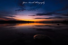 Still Waters Run Deep (Yarin Asanth) Tags: atmosphere goldenlight yellow afterglow passion afterwork story bolders landscape coloured red blue clouds untersee calm flat lake bodensee water surface sundown sunset lakeconstance yarinasanthphotography gerdkozikphotography yarinasanth gerdkozik