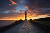 Explosive light (PMagonza) Tags: lighthouse faro costa coast sea mar sky red blue yellow amarillo rojo naranja orange azul clouds nubes navia asturias cantábrico person fotógrafo photographer contraluz light sombras shadows luz