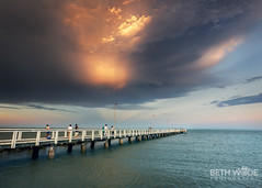 Sunset Storm (Beth Wode Photography) Tags: storm thunderstorm stormclouds sunsetstorm mammatusclouds sunset jetty pier wellingtonpoint redlands wellingtonpointjetty beth wode bethwode