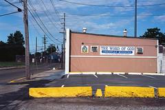 Cut curb, MLK Blvd. (ADMurr) Tags: clarksdale cut yellow curb church mlk drive 4th dab140 leica m6 summicron 50mm kodak ektar film