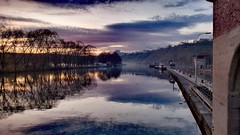 Reflection of the dawn (DrQ_Emilian) Tags: sunset sunlight light colors nature sky clouds dawn evening mood reflection trees river landscape urban fog foggy mist misty dark boat fall autumn season outdoors neckar stuttgart germany badenwürttemberg europe travel maxeythsee