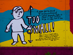 Too Small (Steve Taylor (Photography)) Tags: boy dreamland toosmall minimumheight rock art graffiti mural streetart black blue yellow orange red white paint kid child lad uk gb england greatbritain unitedkingdom margate