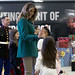 First lady high fives a child during the Toys for Tots event.