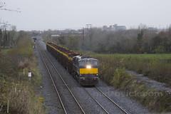 084 on Westport-Waterford timber train at Killinard 10-Nov-17 (metrovick) Tags: irishrail iarnrodeireann ie071class ie084 emd emdexportloco jt22cw timbertrain freighttrain railroad railway railwaylaois