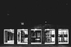 night prowler (matthias hämmerly) Tags: switzerland candid street streetphotography shadow contrast grain ricoh gr black white bw monochrom monochrome city town urban blackandwhite strasse people monochromphotography dark zürich zuerich lonely swiss windows wall geometry lines einfarbig architektur night window light shop man