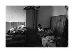 Boy with hanger (Jan Dobrovsky) Tags: bedroom leicaq blackandwhite krásnálípa monochrome boy indoor people reallife roma northernbohemia grain social gypsies document human